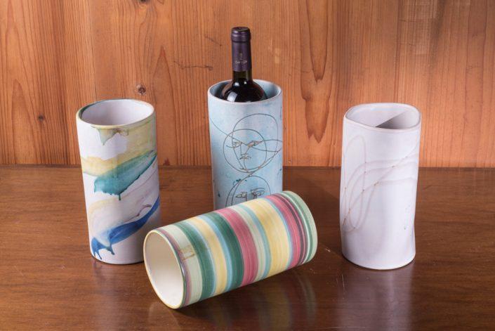 Vasi cilindro in maiolica decorati o incisi a mano (portabottiglie,portafiori,portamestoli).